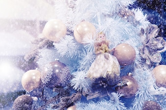 Christmas balls and a doll on a tree