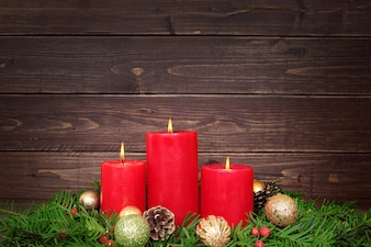 Christmas candles with wooden background