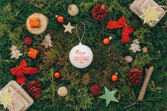 Christmas composition with ball on grass