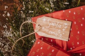 Christmas composition with tag and gifts