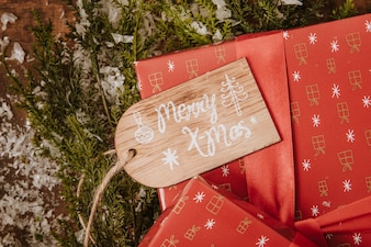 Christmas composition with tag on gift box