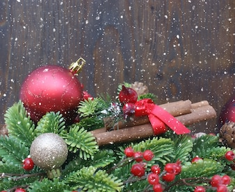 Christmas decorations on wooden background with snowy effect