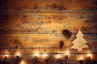 Christmas lights bulb with decoration on wood table. Merry christmas (xmas) background. topview, border design - rustic and vintage styles