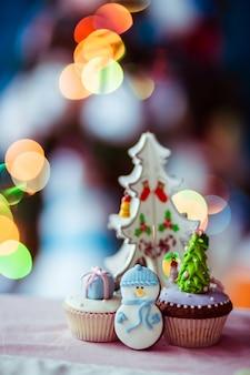 Christmas tree above cupcakes