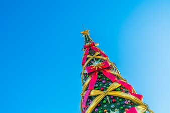 Christmas tree with big bows on a blue background on diagonal