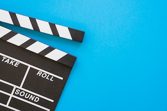 Clapperboard on blue background