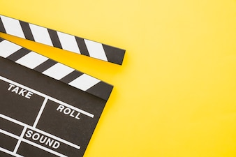 Clapperboard on yellow background