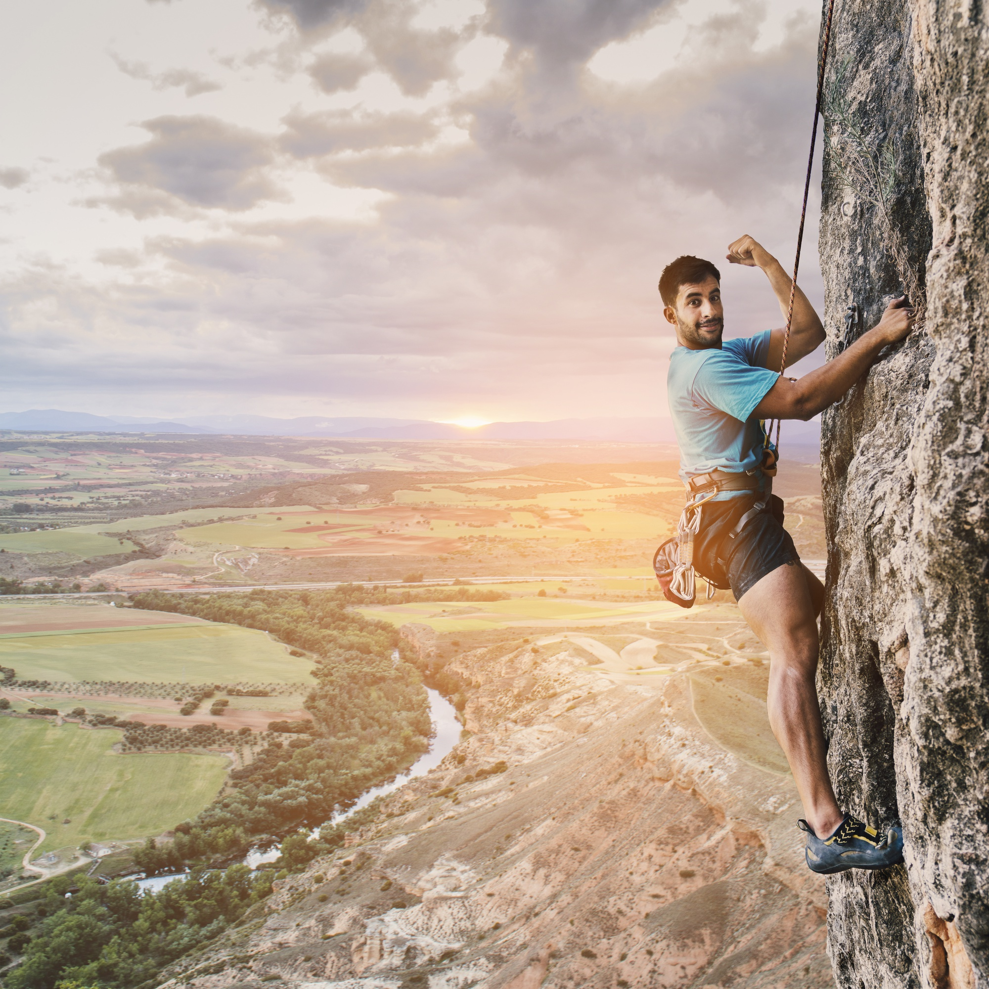 Climber on wall with landscape