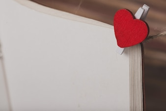 Clip with a heart set on a page of a book
