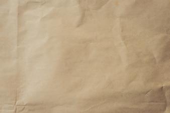 Закройте коричневый фон бумаги и текстуры.