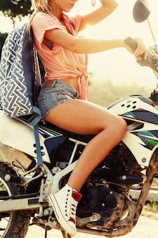 Close-up of attractive woman driving a motorcycle