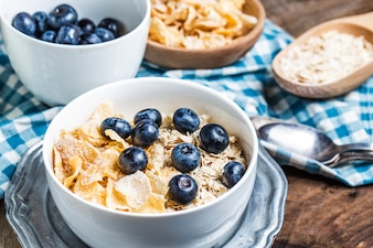 Close-up of bowl with tasty blueberries and cereals