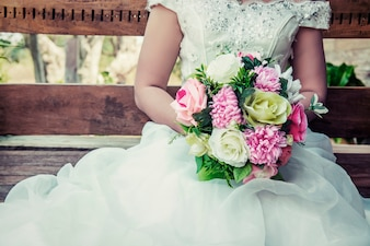 Close-up of bride holding her colorful bouquet