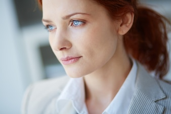 Close-up of business woman with blue eyes