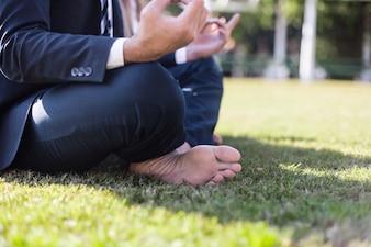 Close-up of businessman sitting cross-legged