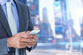 Close-up of businessman using his mobile