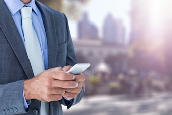 Close-up of businessman using his smartphone