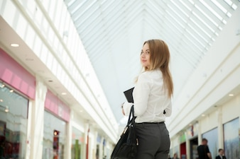 Close-up of businesswoman posing in the mall