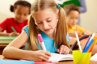 Close-up of creative girl drawing