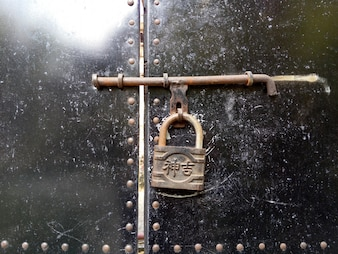 Close-up of door with a padlock