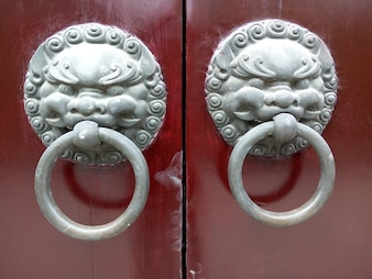 Close-up of doorknobs with lions head