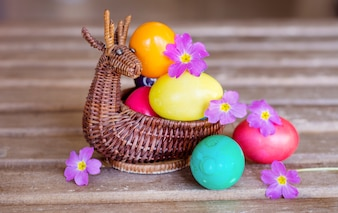 Close-up of easter eggs with purple flowers