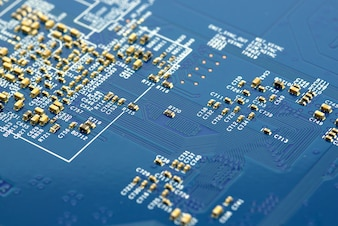 Close-up of electronic microchip circuit board with processor  background