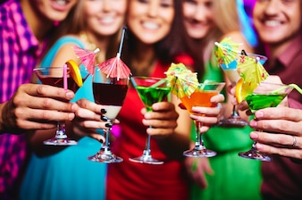 Close-up of friends with cocktails