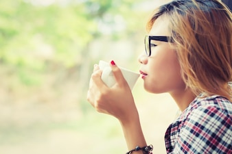 Close-up of girl drinking coffee with blurred background