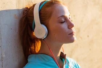 Close-up of girl listening to music