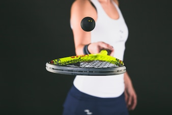 Close-up of girl playing with racquet and ball