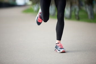 Close-up of girl running with sneakers