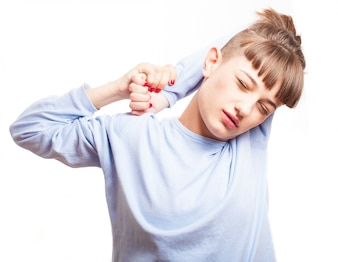 Close-up of girl stretching her aching arms