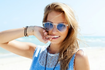Close-up of girl with a big smile on the beach
