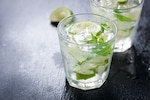 Close-up of glass with lemon slices and spearmint