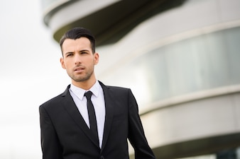 Close-up of good looking businessman with black tie