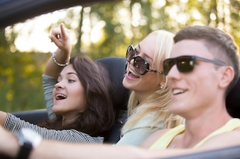 Close-up of group of friends in the convertible