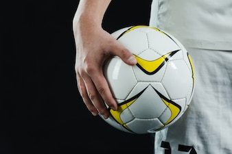 Close-up of hand holding a soccer ball