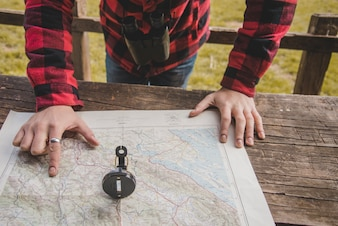 Close-up of hand pointing a point on the map