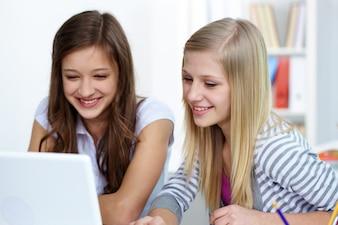 Close-up of joyful girls in class