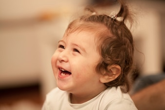 Close-up of little girl laughing