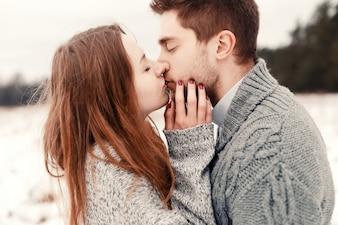 Close-up of passionate woman kissing her handsome boyfriend