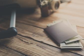 Close-up of passport with bills