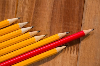 Close-up of pencils on wooden table