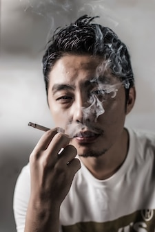 Close-up of pensive man smoking