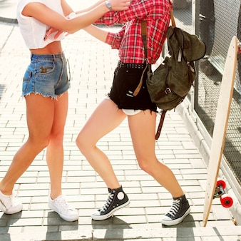 Close-up of playful women in shorts