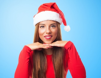 Close-up of pretty woman wearing santa claus hat