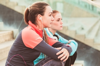Close-up of relaxed sportswomen