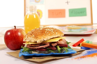 Close-up of roast beef sandwich with orange juice