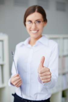 Close-up of secretary showing thumbs up